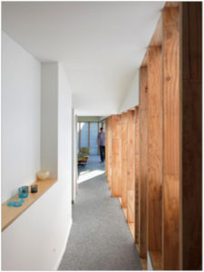 Hallway with translucent Sheets framed by wooden posts