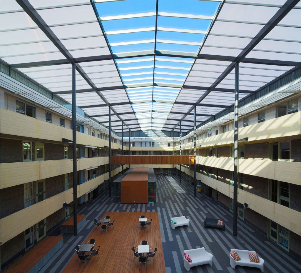Natural Lighting Building with Commercial Flat Roofing Extensions UNSW New College Kensington, Sydney - refurbishment solved natural lighting Polycarbonate Glazing Energy Health