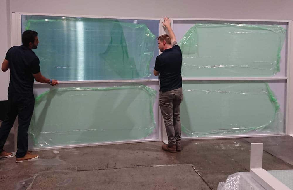 Everbright Blue panels being unpacked at Equinox Sydney