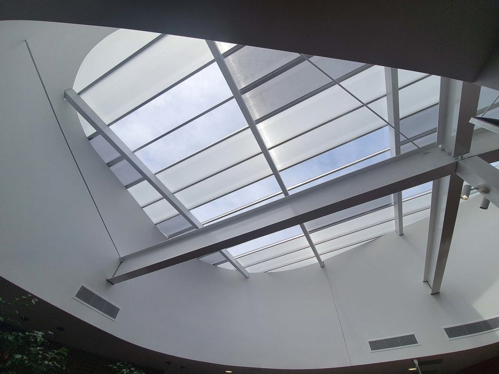 How Translucent Danpalon Roofing sheets improves health by streaming in natural light. MK Lawyers installation of skylight for more daylight