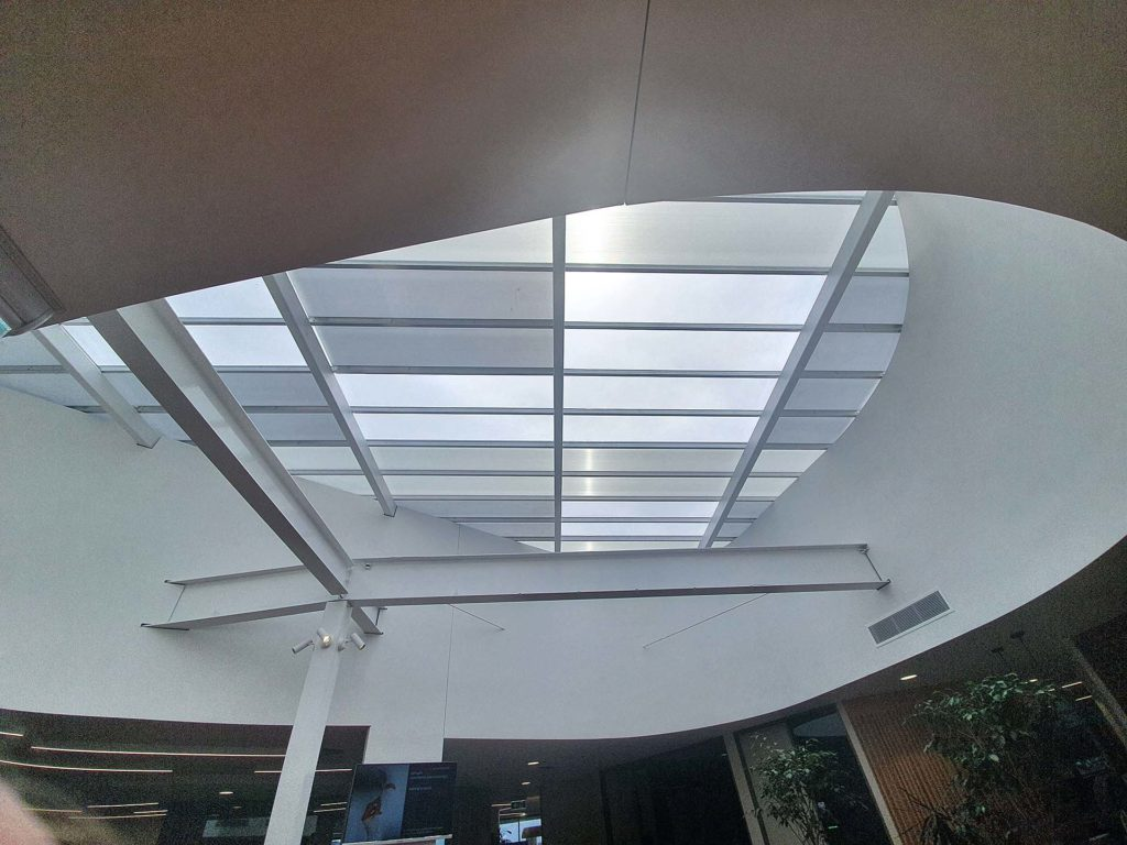 How Translucent Danpalon Roofing sheets improves health by streaming in natural light. MK Lawyers installation of skylight for more daylight V3