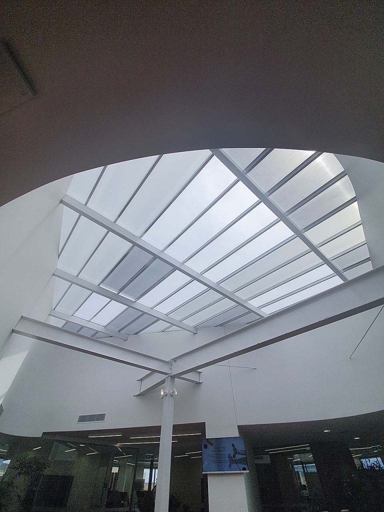 How Translucent Danpalon Roofing sheets improves health by streaming in natural light. MK Lawyers installation of polycarbonate skylight